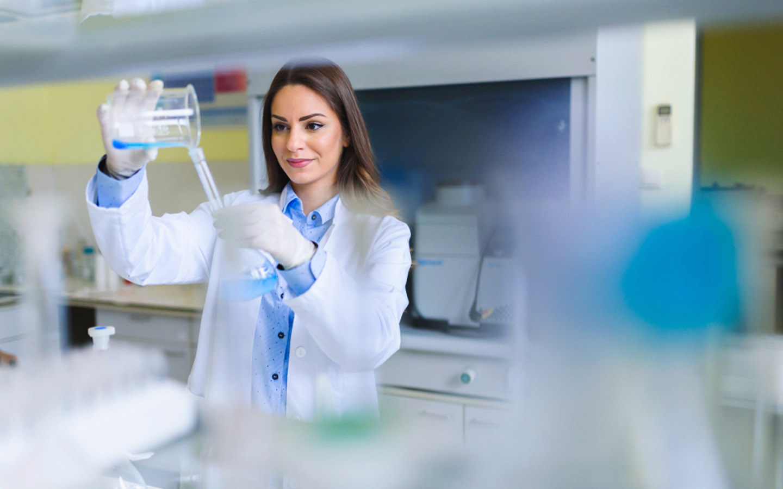 pharmacy student using beakers