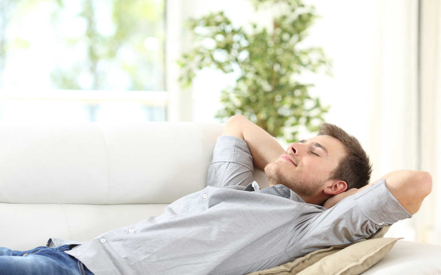 A man lying on a couch