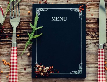 Restaurant menu on rustic table