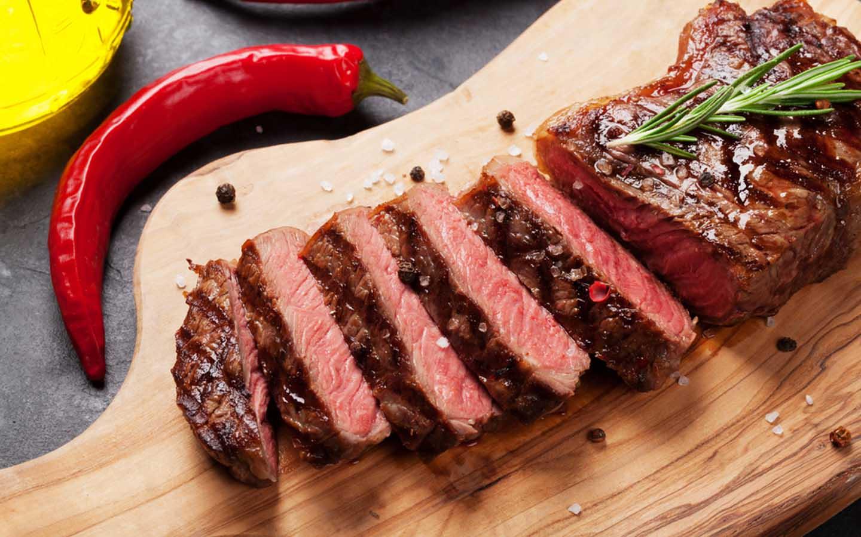 Finely-cut slices of strip loin steak