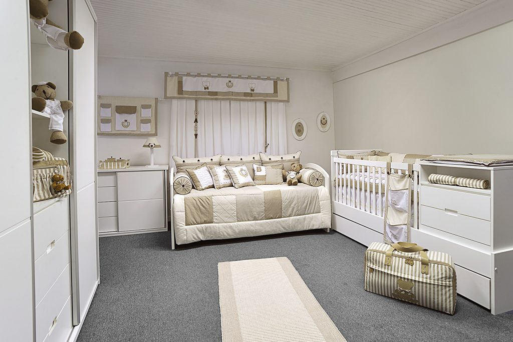 A child's room and a nursery in one with a pull out sofa and the baby's crib next to each other
