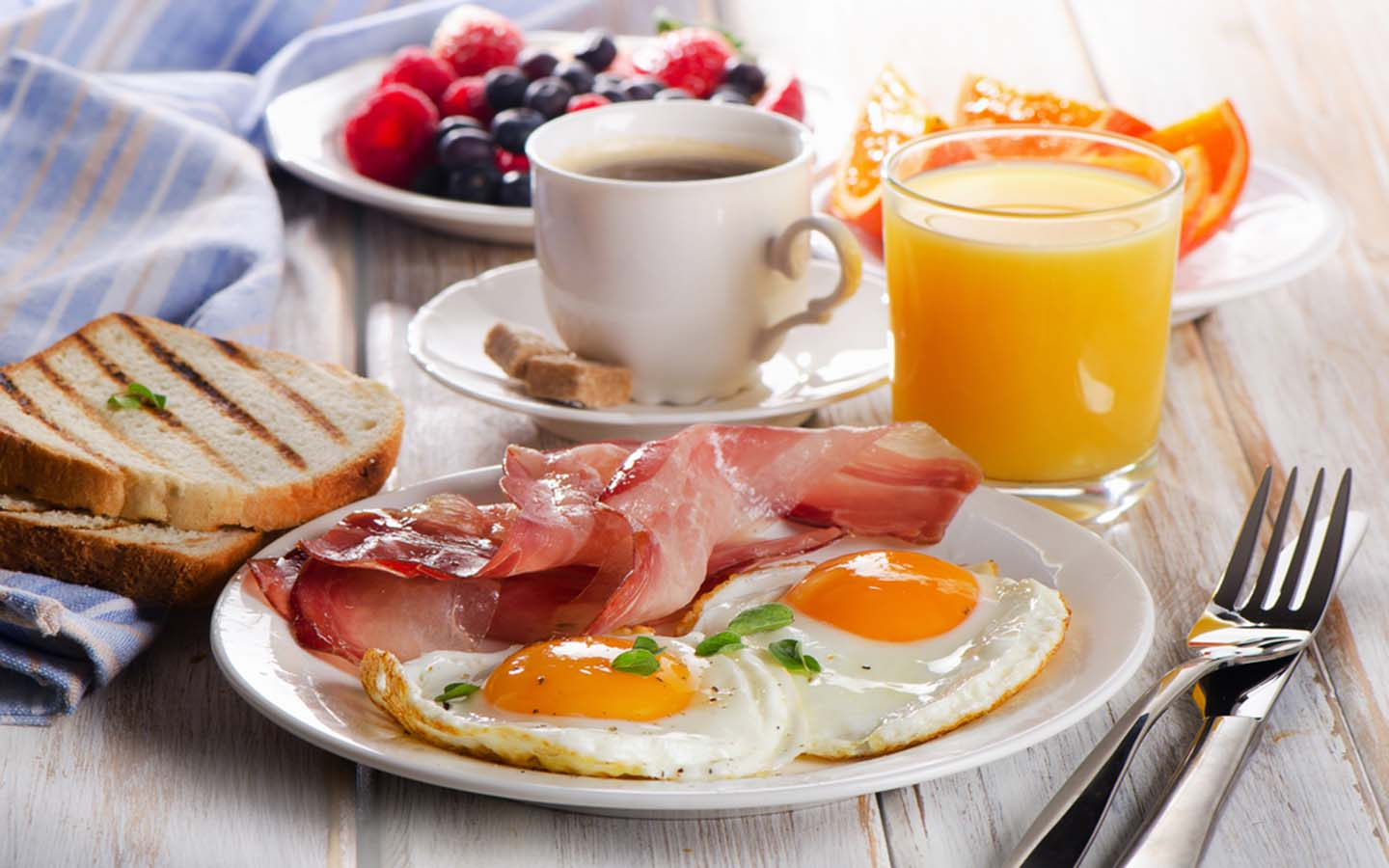 Coffee, juice, egg and toast along with other classic breakfast options