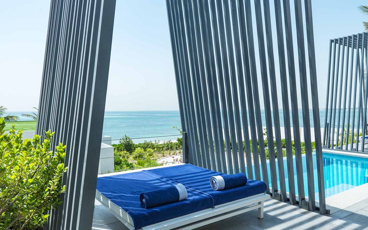 day bed by the pool at zaya nurai