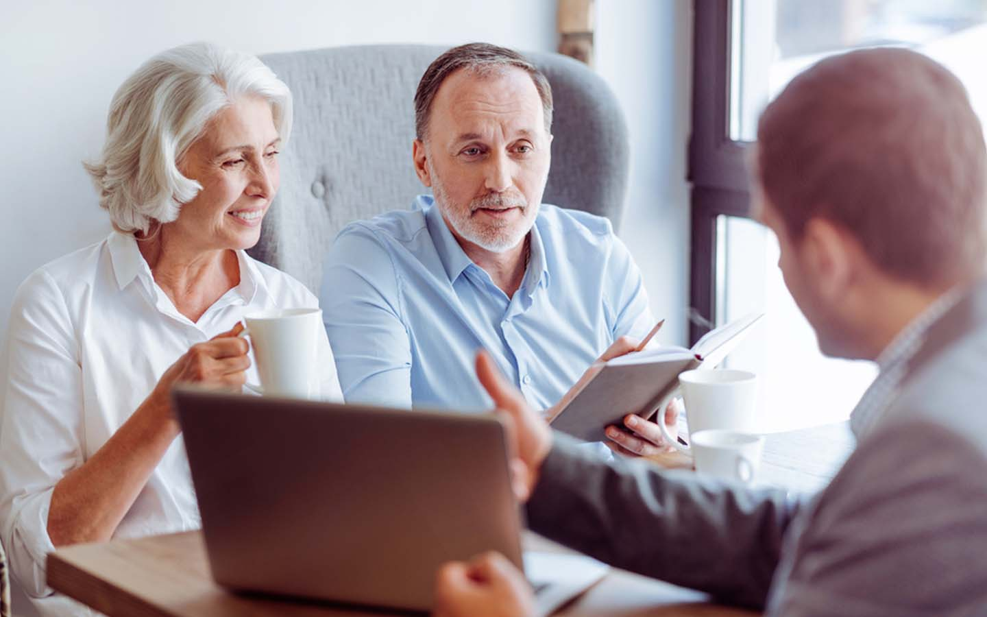 A couple discussing a health insurance plan with an agent