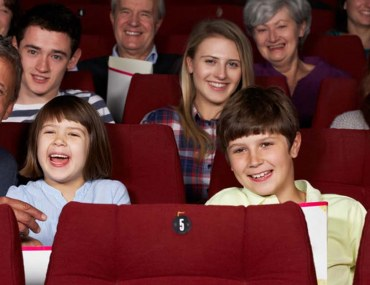 Children and teenagers enjoying a movie