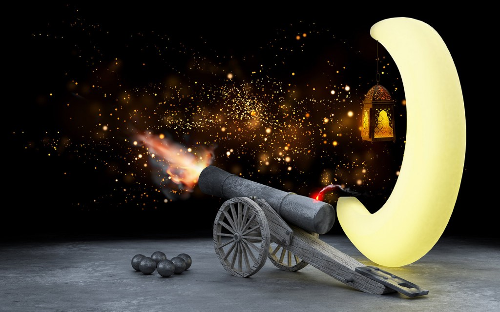 Image of cannon firing and crescent moon