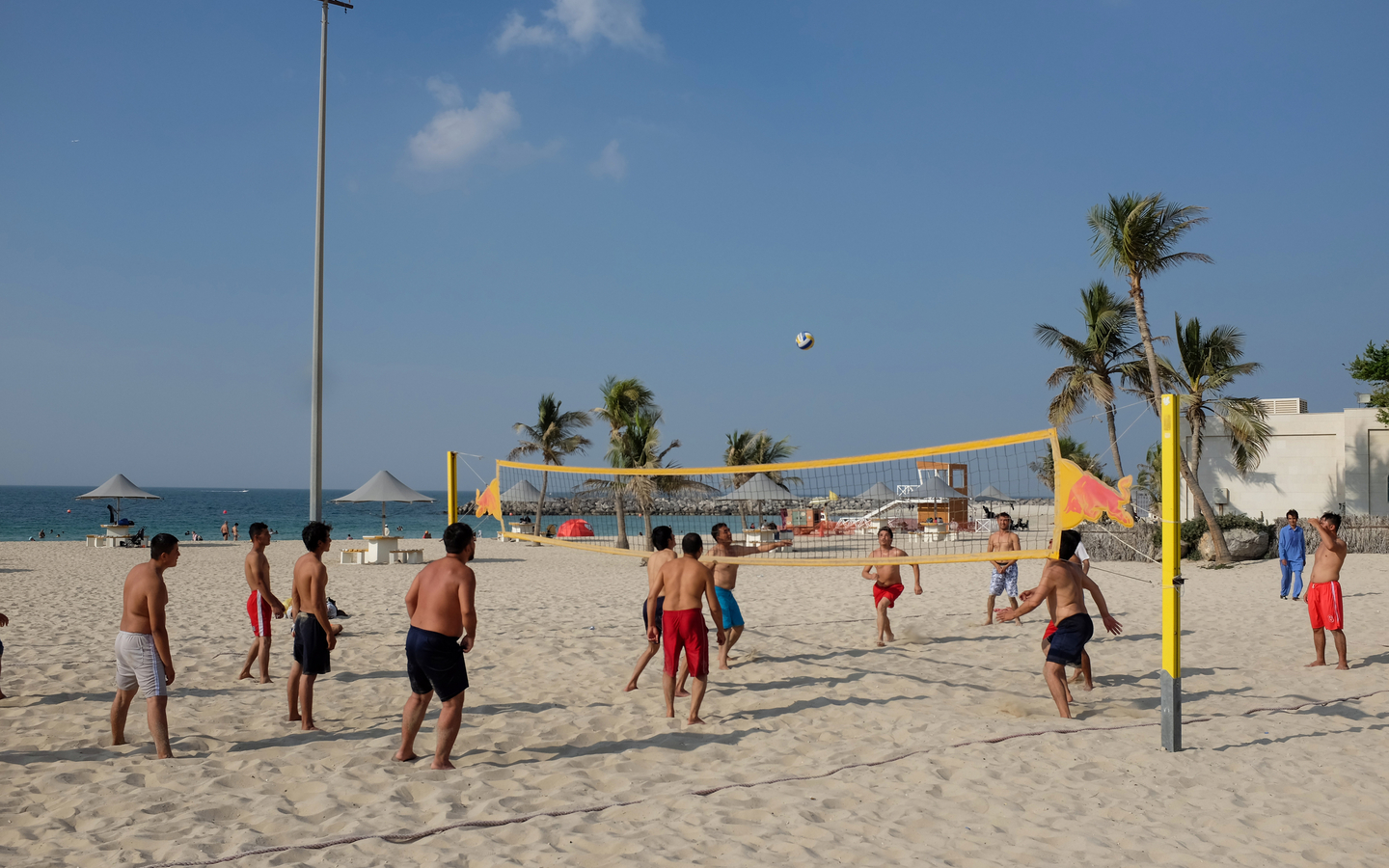 You can play Volly ball with a bunch of friends at Al Mamzar beach