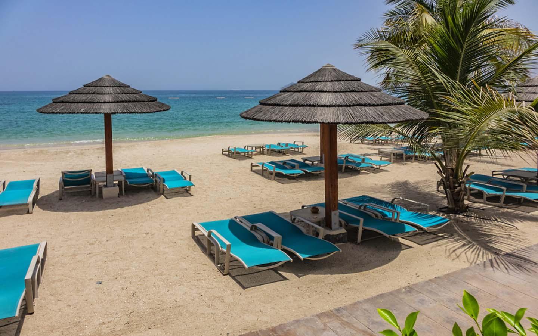 beach huts and sun loungers on Khorfakkan Beach