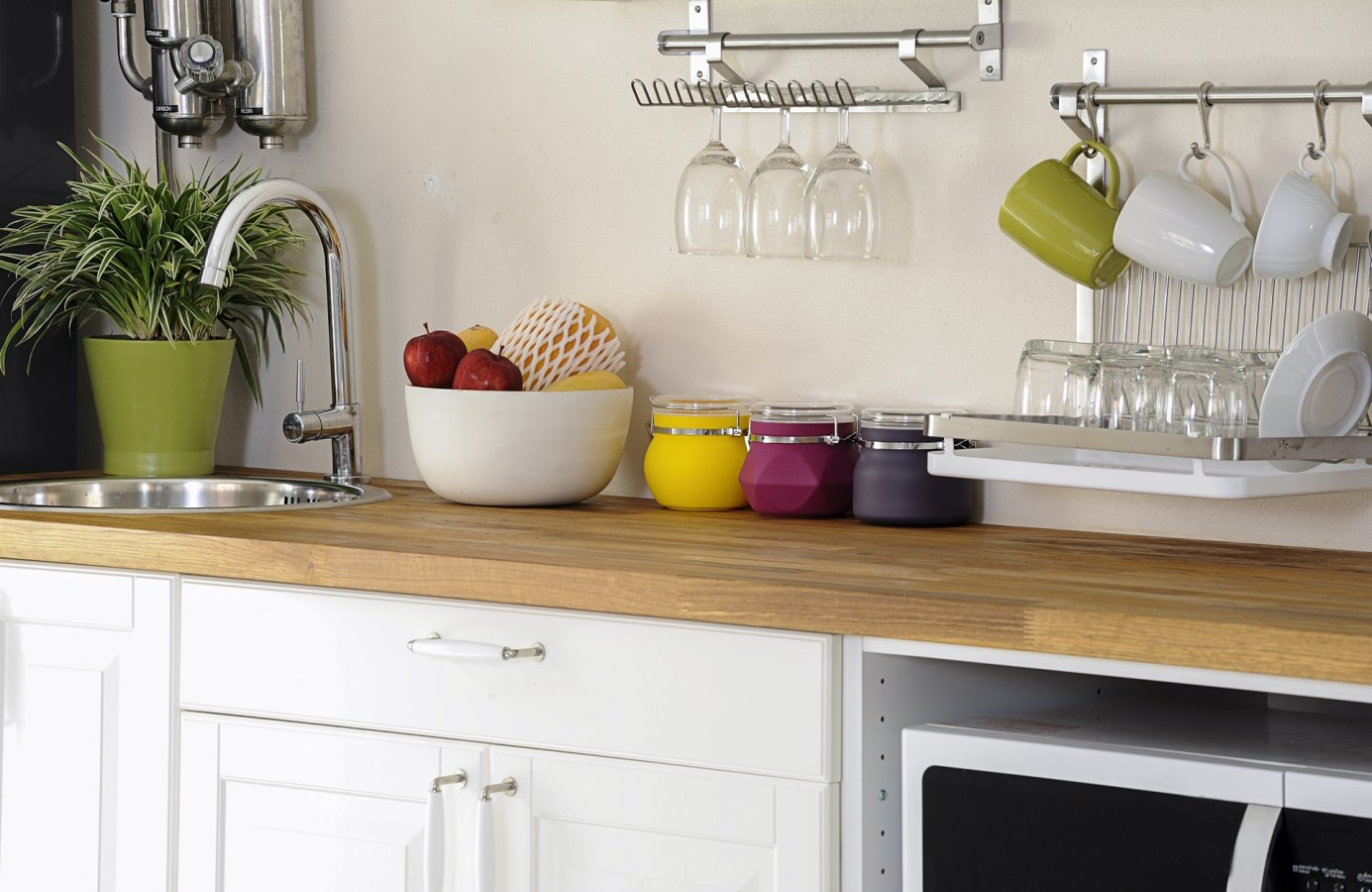 Add a place rack to make your kitchen look more homely and colourful