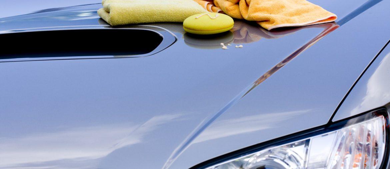 Wax and towels on car hood