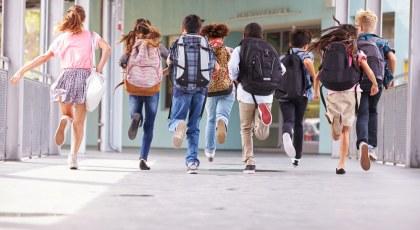 Students running the corridor of one of the best british schools in Dubai