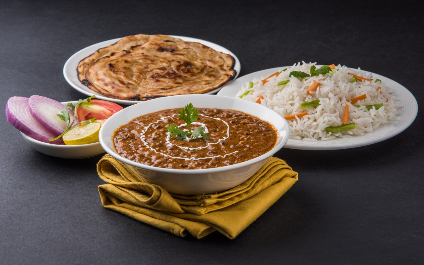 Daal Makhni served with butter roti and plain rice