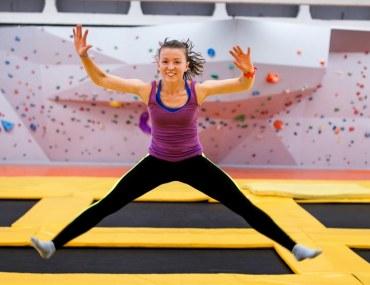Girl jumping at trampoline park