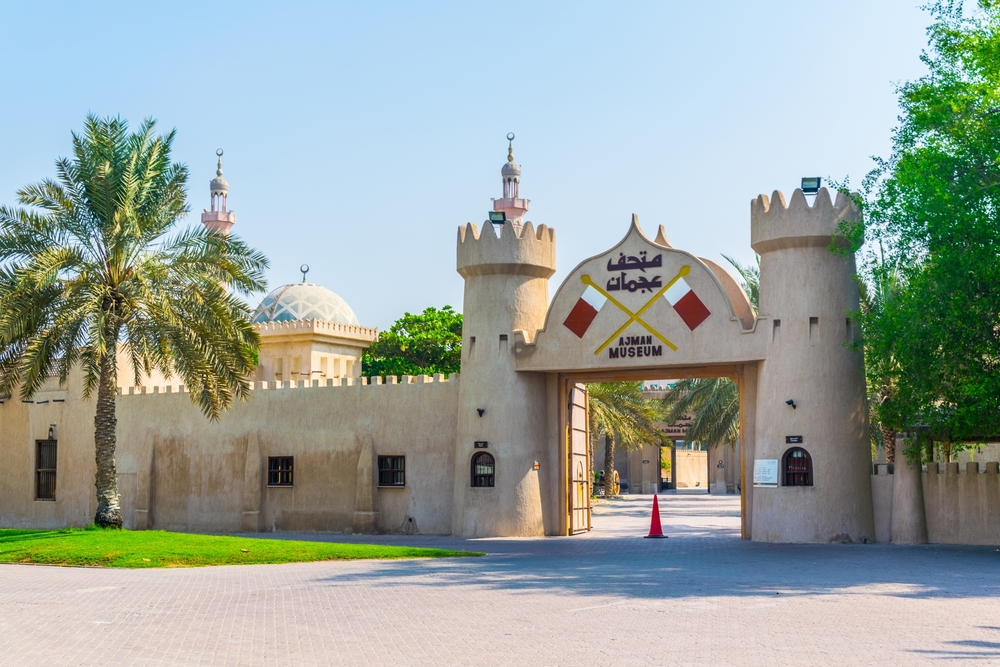 The gate leading into a fortress-like Ajman museum on a bright sunny day
