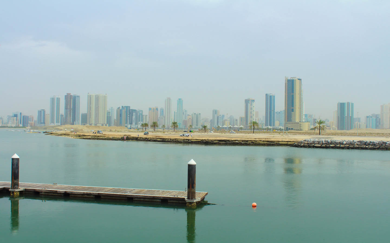 shoreline with Sharjah's skyline