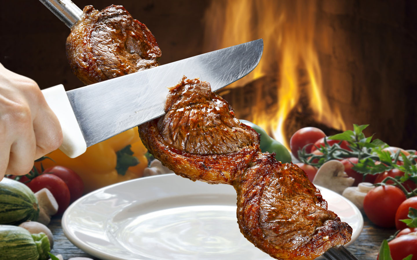 Brazilian BBQ on a grill available at restaurants in Deira