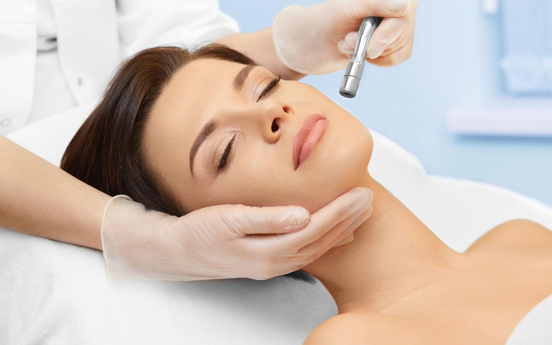 A woman is undergoing a skin rejuvenation procedure