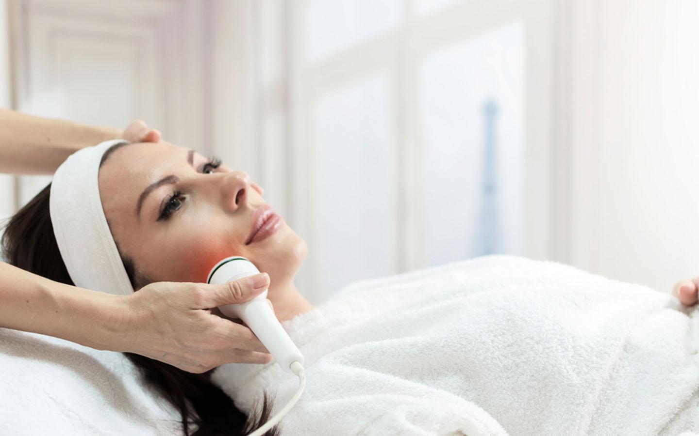 Beautiful woman getting laser skin treatment