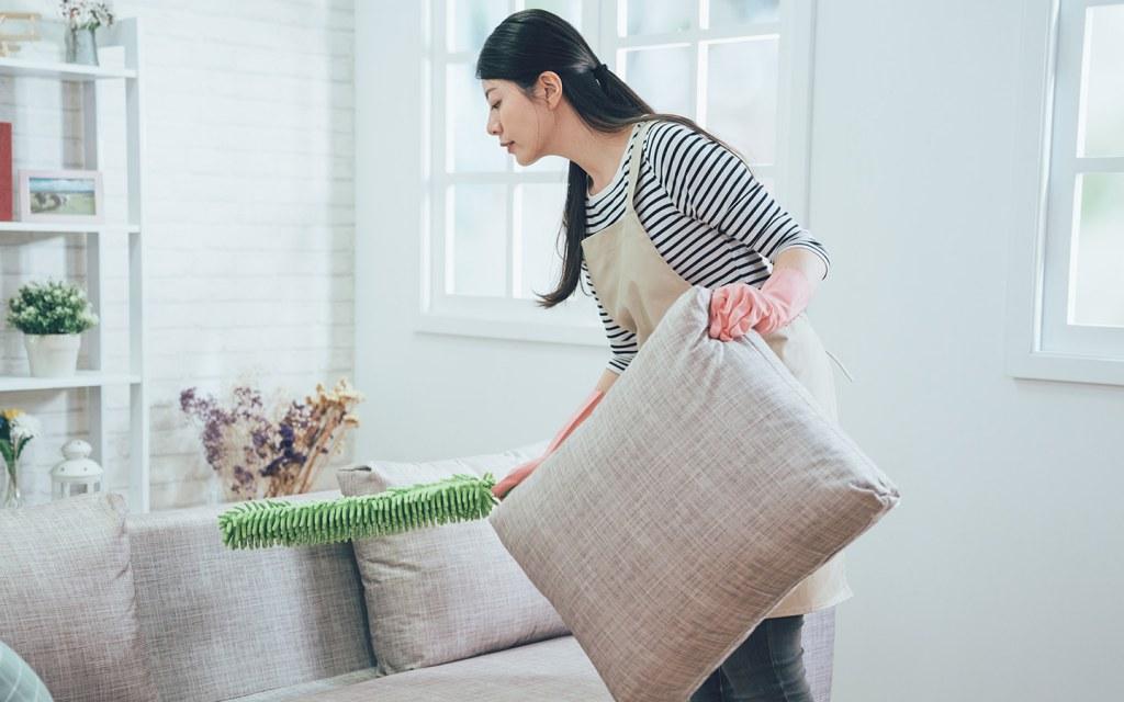 Woman dusting in a rental villa in Dubai