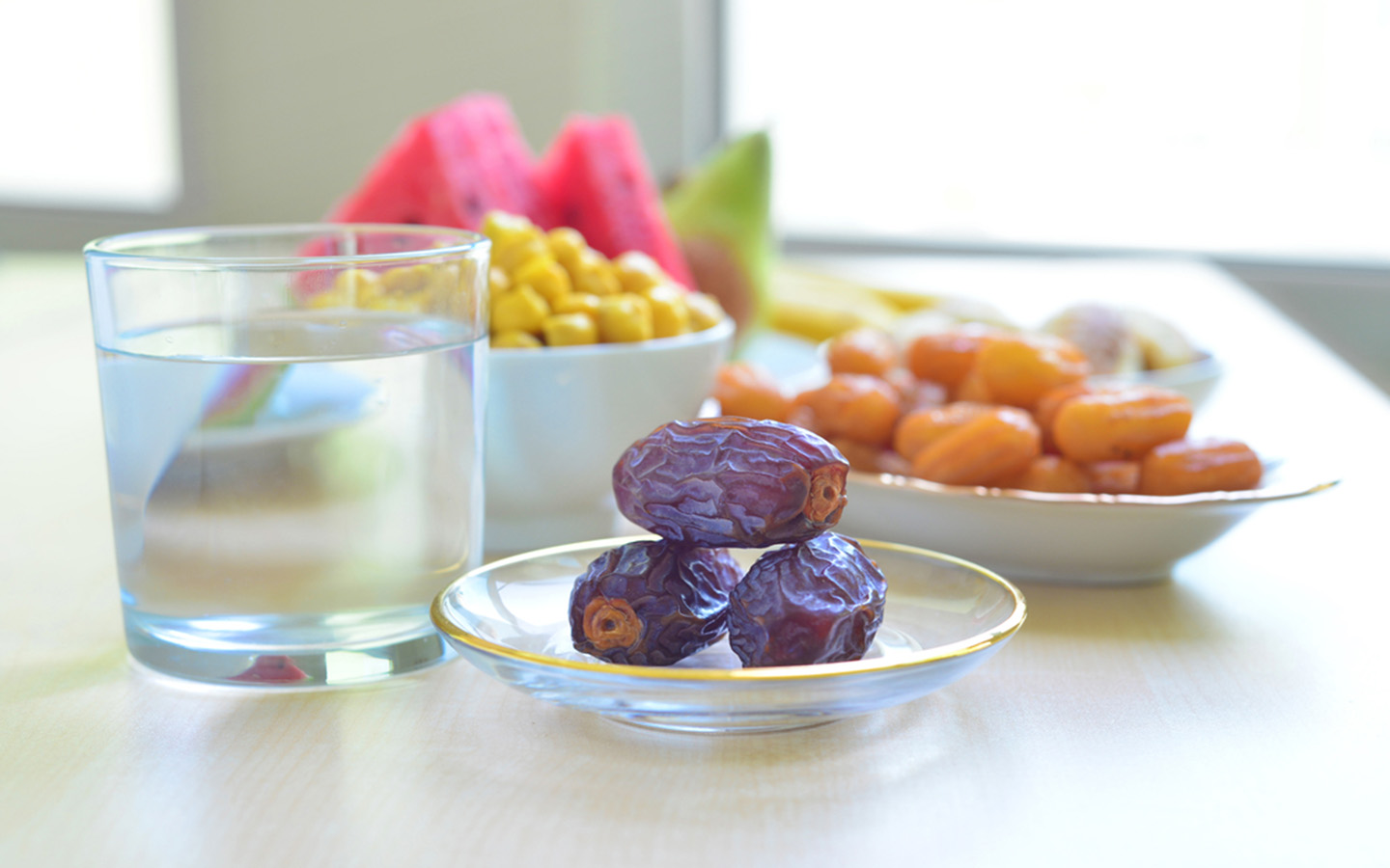 Water and fruits lying on the table