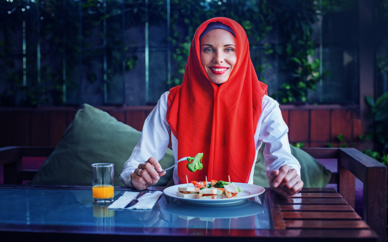 A woman enjoying Suhoor in Dubai