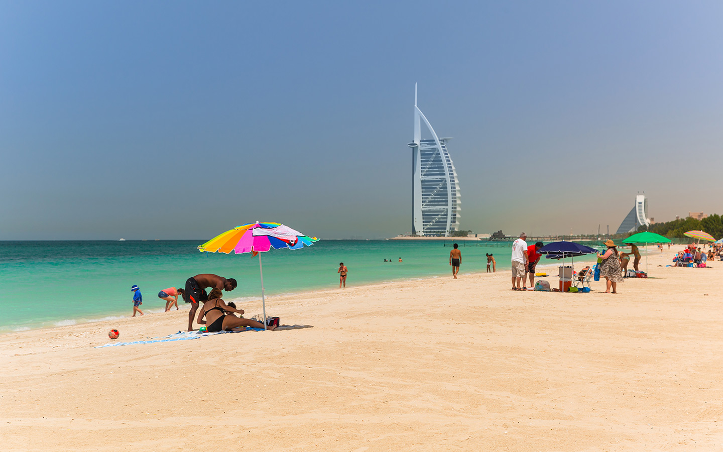 People relaxing at Jumeirah Public Beach