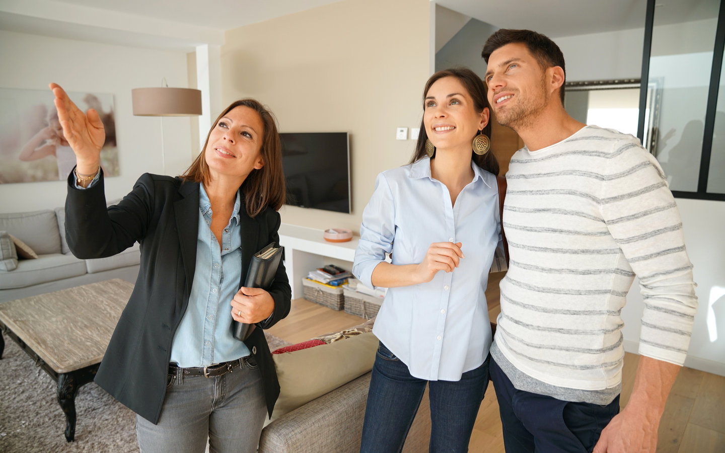 Realtor and couple at a property biewing
