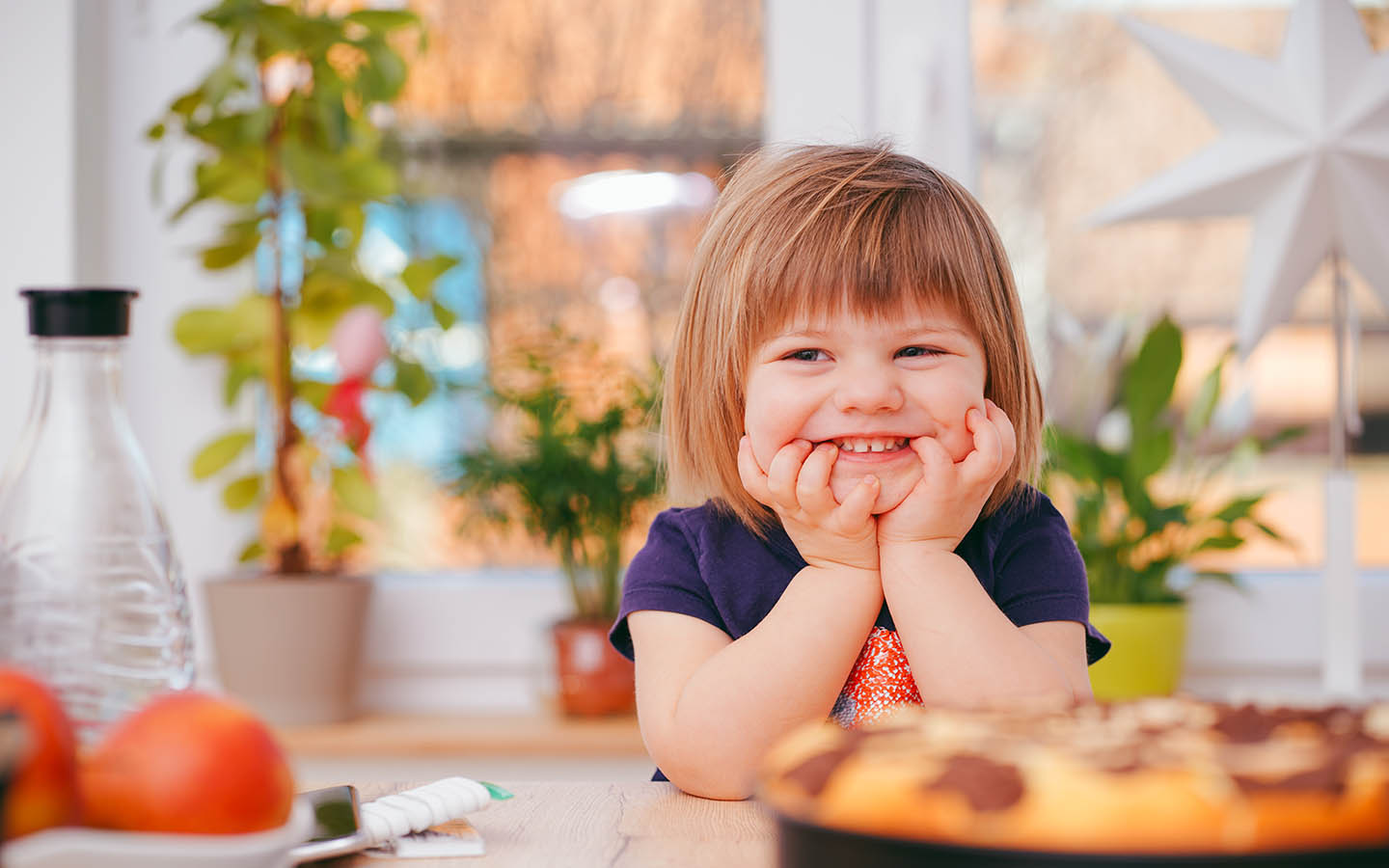Girl posing after making a kids meal during a cooking activity