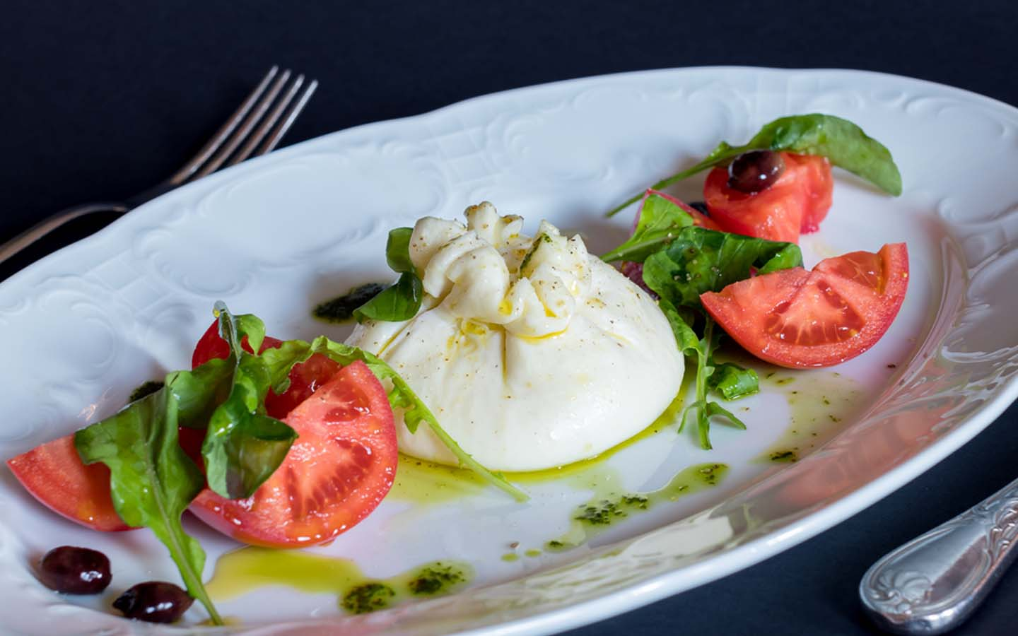 tomato burrata being served to guests