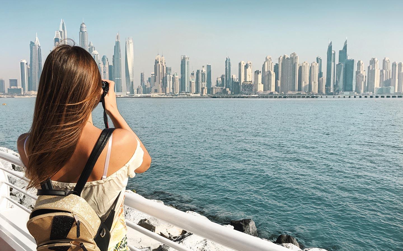 tourist is clicking an image of Dubai's landscape