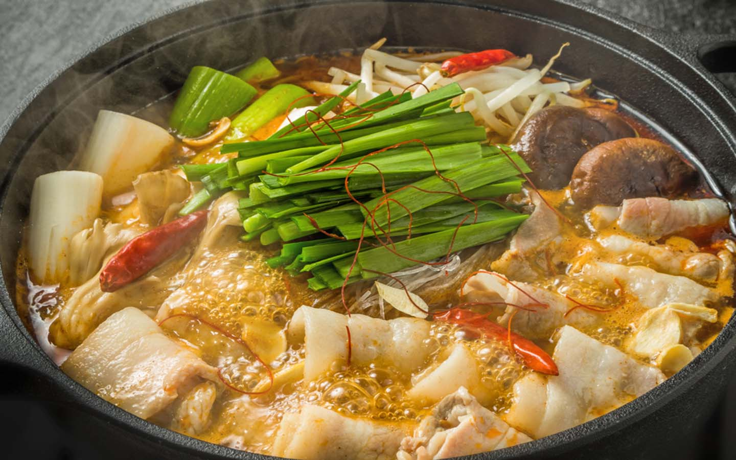 Hot pot garnished with herbs