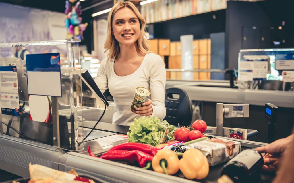 woman at supermarket counter