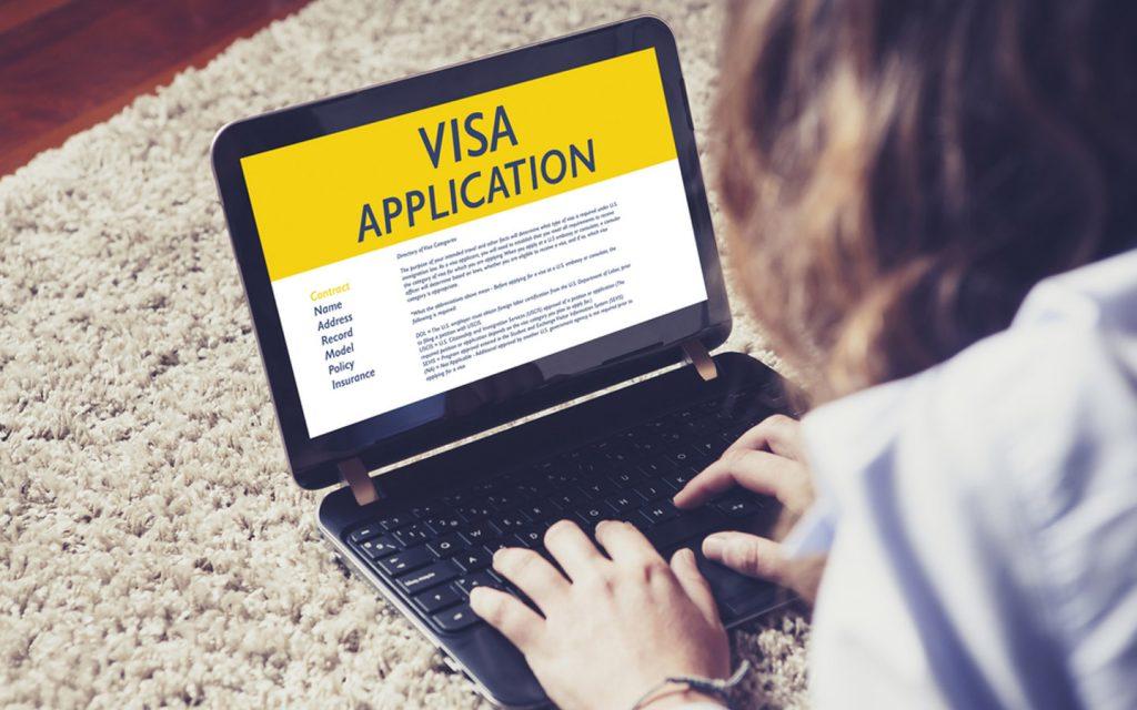 woman filling visa application