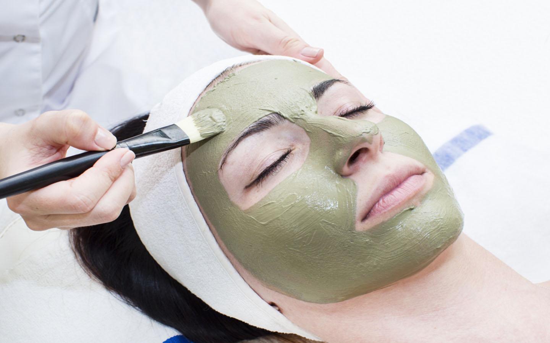 woman getting herbal facial