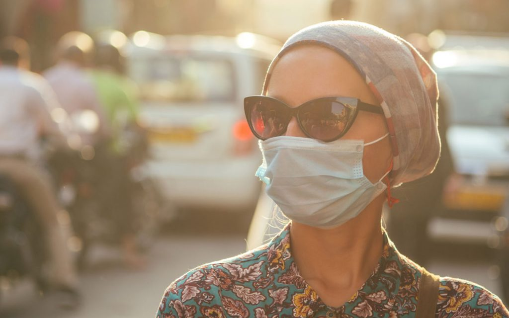 woman wearing a dust mask