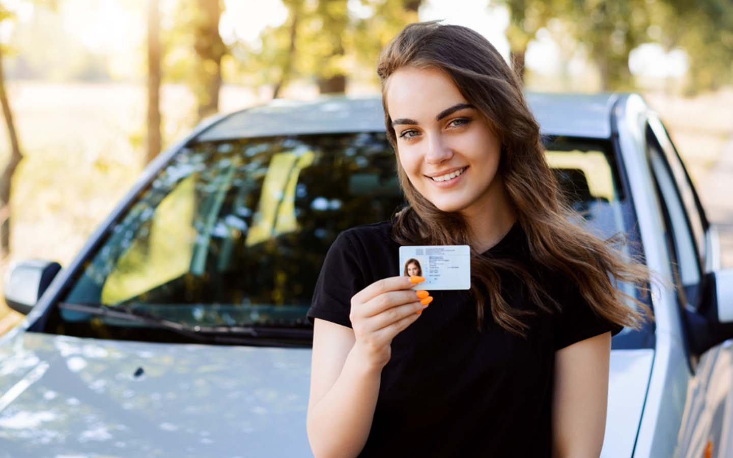 young woman with a driving license